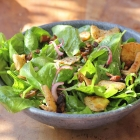 Baby spinach salad with pita croutons, dates and almonds