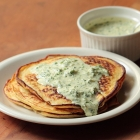 Potato pancakes with cold herb sauce